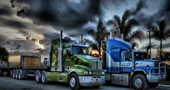 8589130519846-two-trucks-parked-under-stormy-clouds-r-wallpaper-hd
